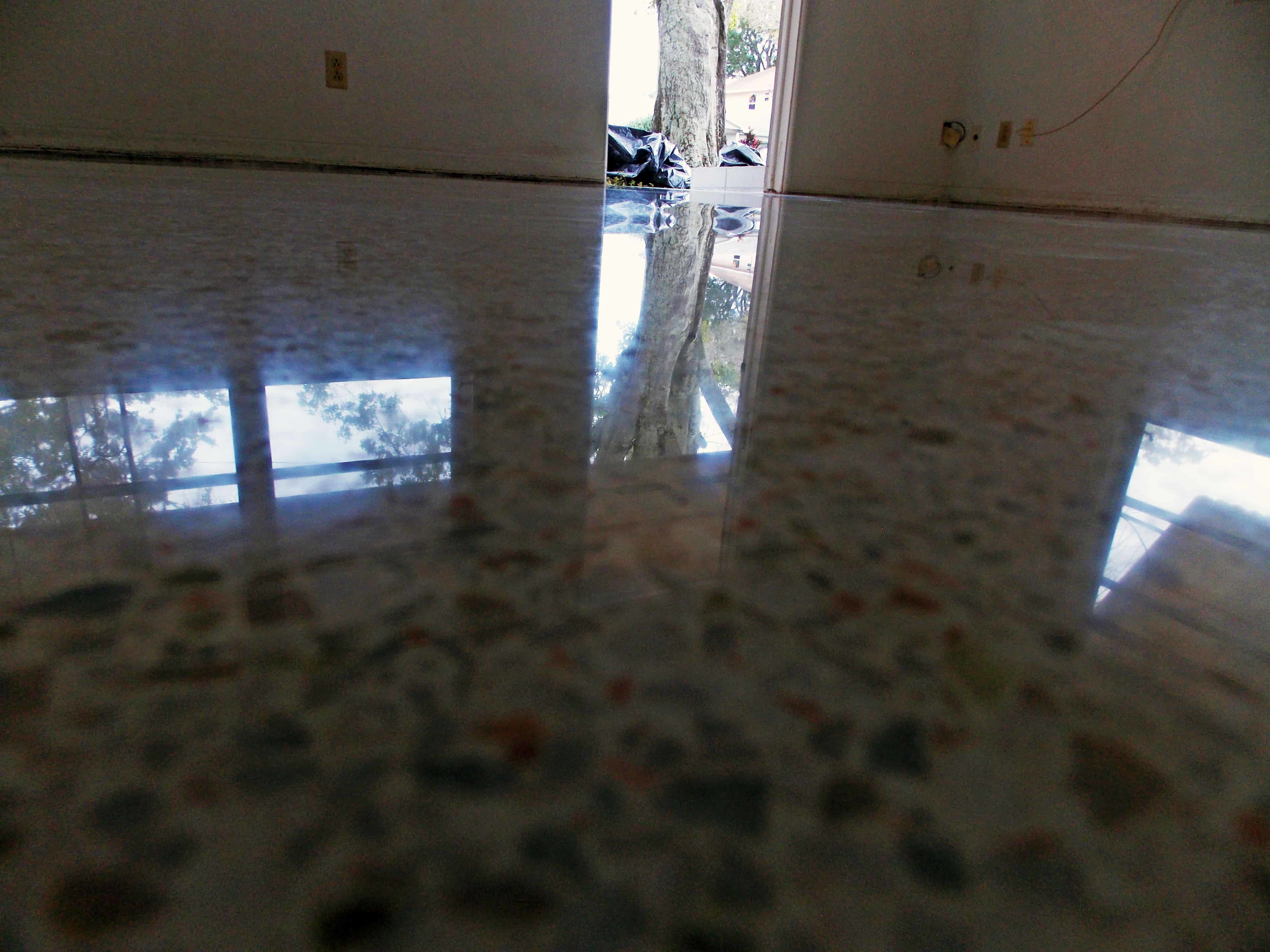 Pad Damage mostly removed from terrazzo.